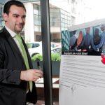 "Ilias Papageorgiadis signing the ""Real Estate is good"" declarataion"